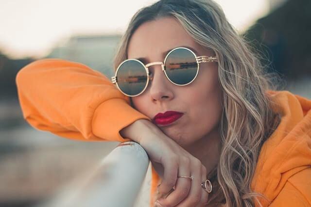 woman gold sunglasses