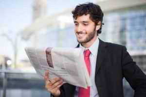man-reading-newspaper-300x200