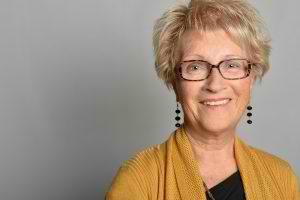 older-woman-in-mustard-top-