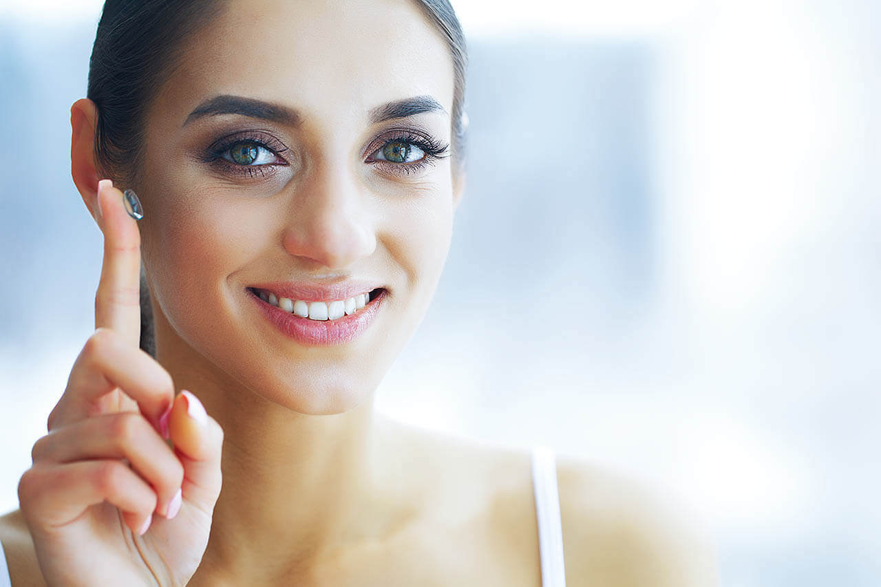 Health And Beauty. Beautiful Young Girl With Contact Lenses. Wom