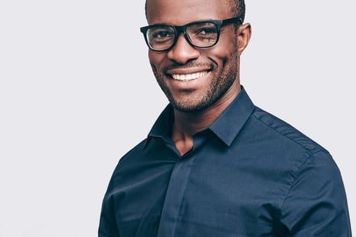 Man Smiling Black Glasses min