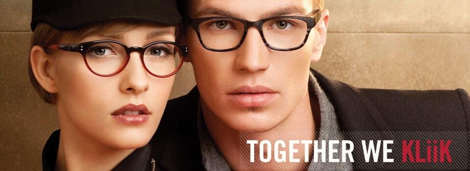 Couple Wearing Kliik Designer Eyeglass Frames