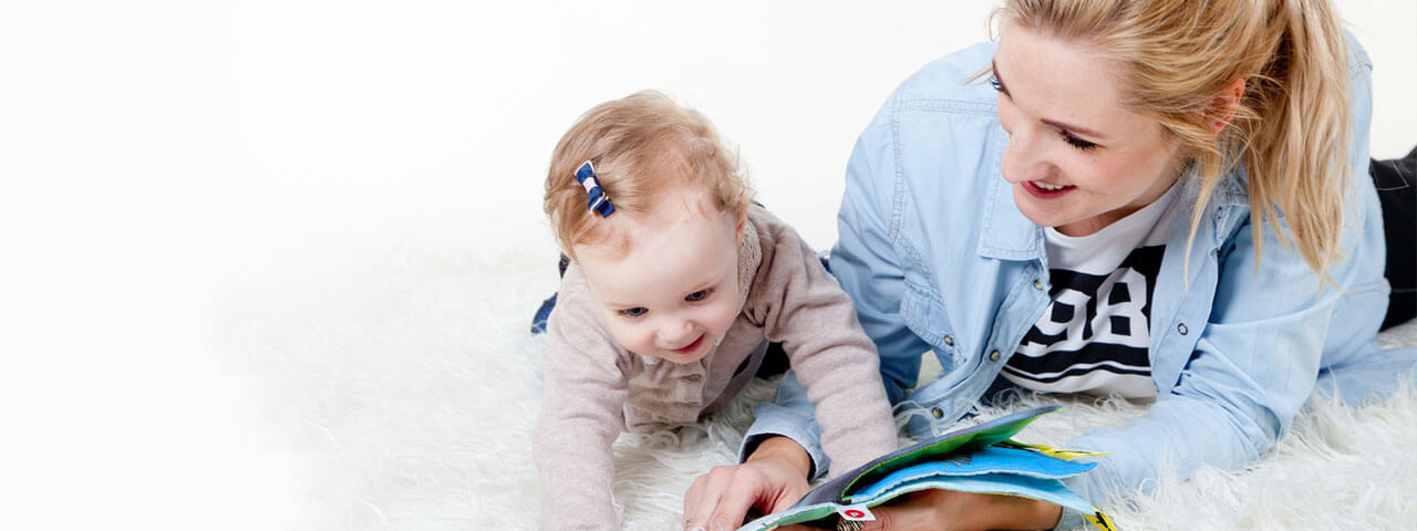 Young-Mother-Reading-to-Baby-1280x480