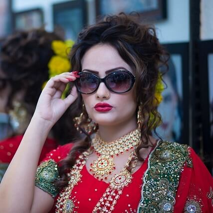 East Indian woman wearing sunglasses