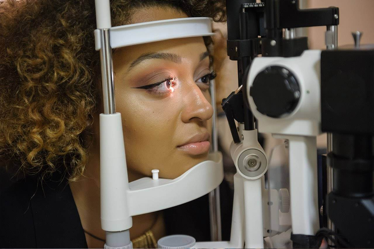woman getting eyes checked