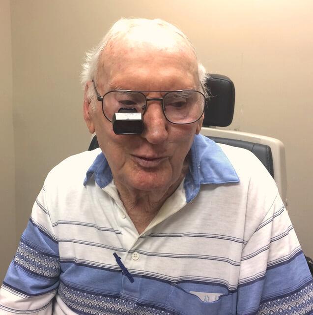 patient wearing bioptic reading glasses