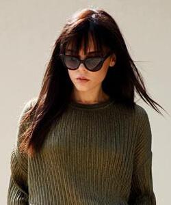 Woman wearing Jimmy Choo Eyewear