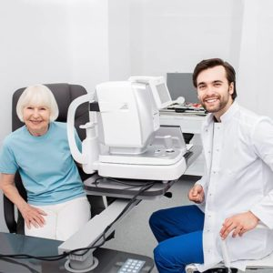 Smiling Optometrist low vision eye exam 640 300x300