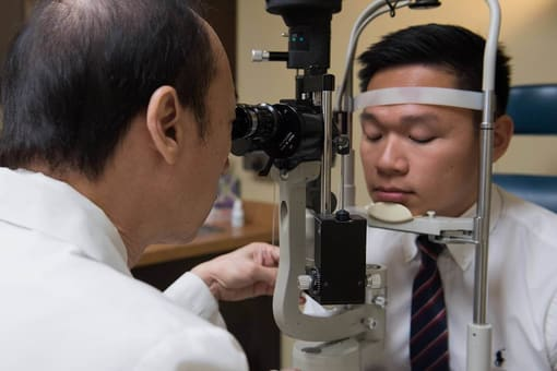 dr. giving eye exam.jpeg