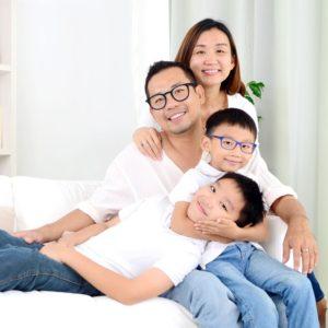family on sofa 300x300