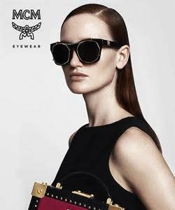 Model wearing MCM sunglasses