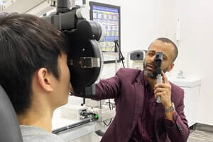doc giving an eye exam min
