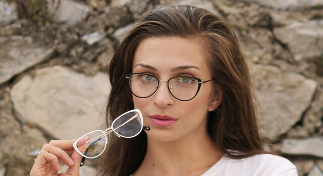 girl holding a pair of glasses 640