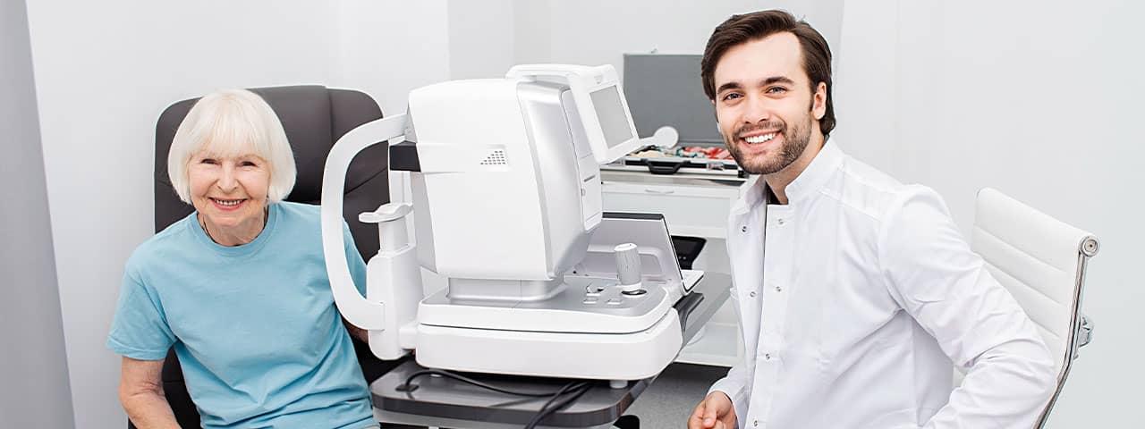 Smiling-Optometrist-low-vision-eye-exam-1280x480-1