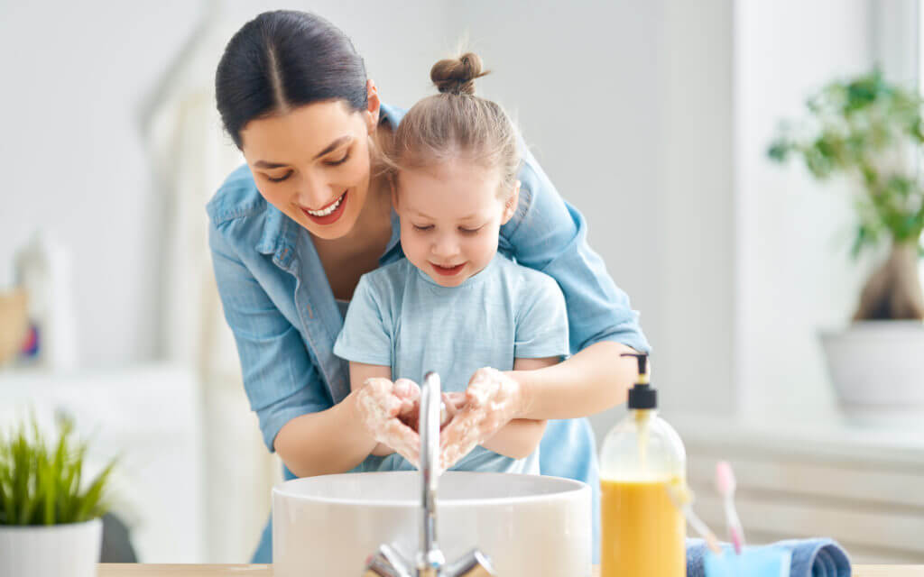 A,Cute,Little,Girl,And,Her,Mother,Are,Washing,Their