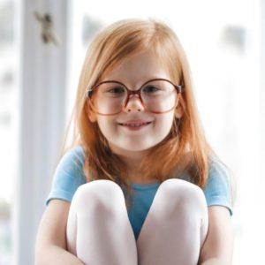 child girl redhead smiling glasses blue ballet dress 640px