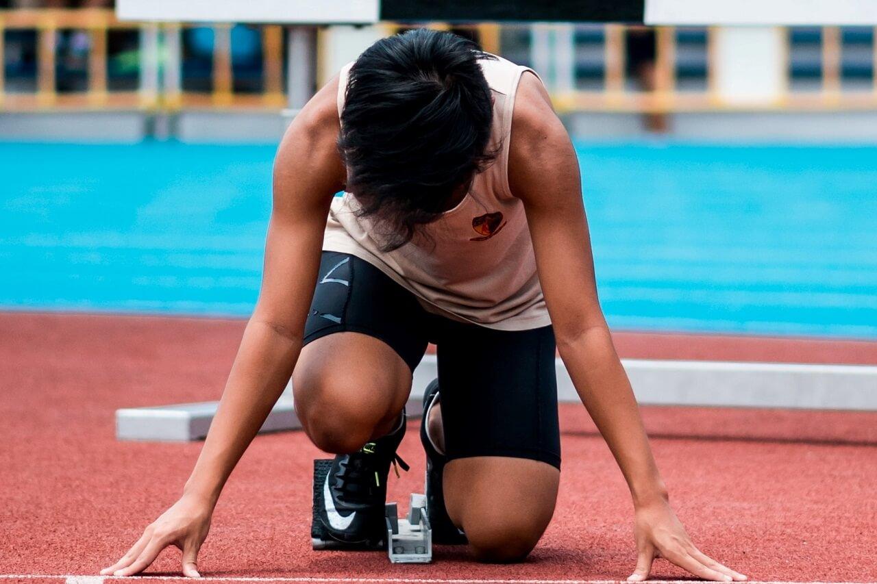 guy running track