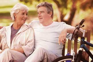 Older Couple Bench Bikes thumbnail