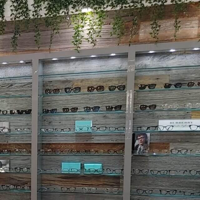 wood wall eyeglass display