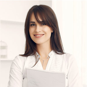 brunette smiling at camera