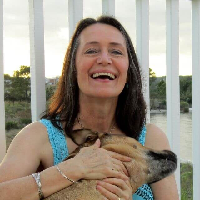 older-senior-caucasian-woman-smiling-with-dog-640px