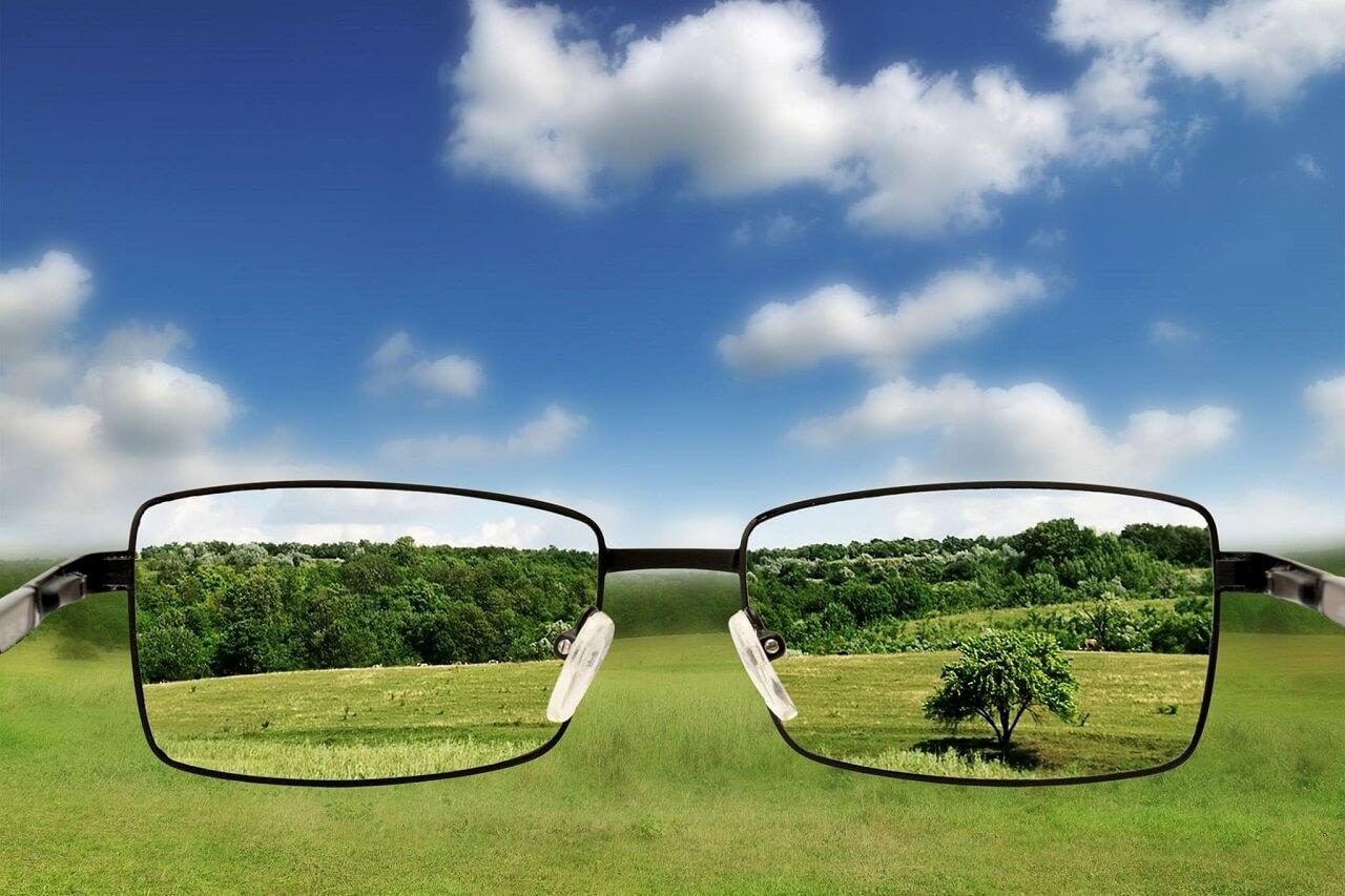 Myopia Management looking through eyeglasses