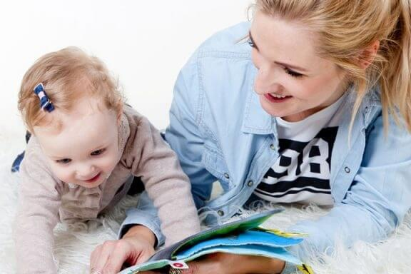Young Mother Reading to Baby