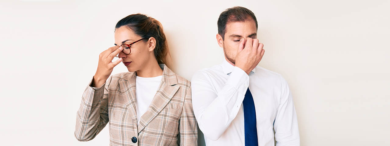 Beautiful couple wearing business clothes tired rubbing nose and