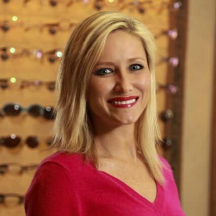 Blonde girl in eyeglass store