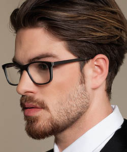 Guy model wearing Gold and Wood eyeglasses