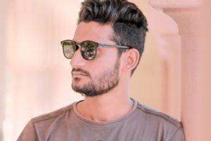 stylish young man sunglasses 300x200