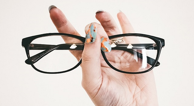 photo-of-person-holding-eyeglasses-1068866-1