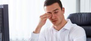 man suffering from dry eyes, rubbing eyes