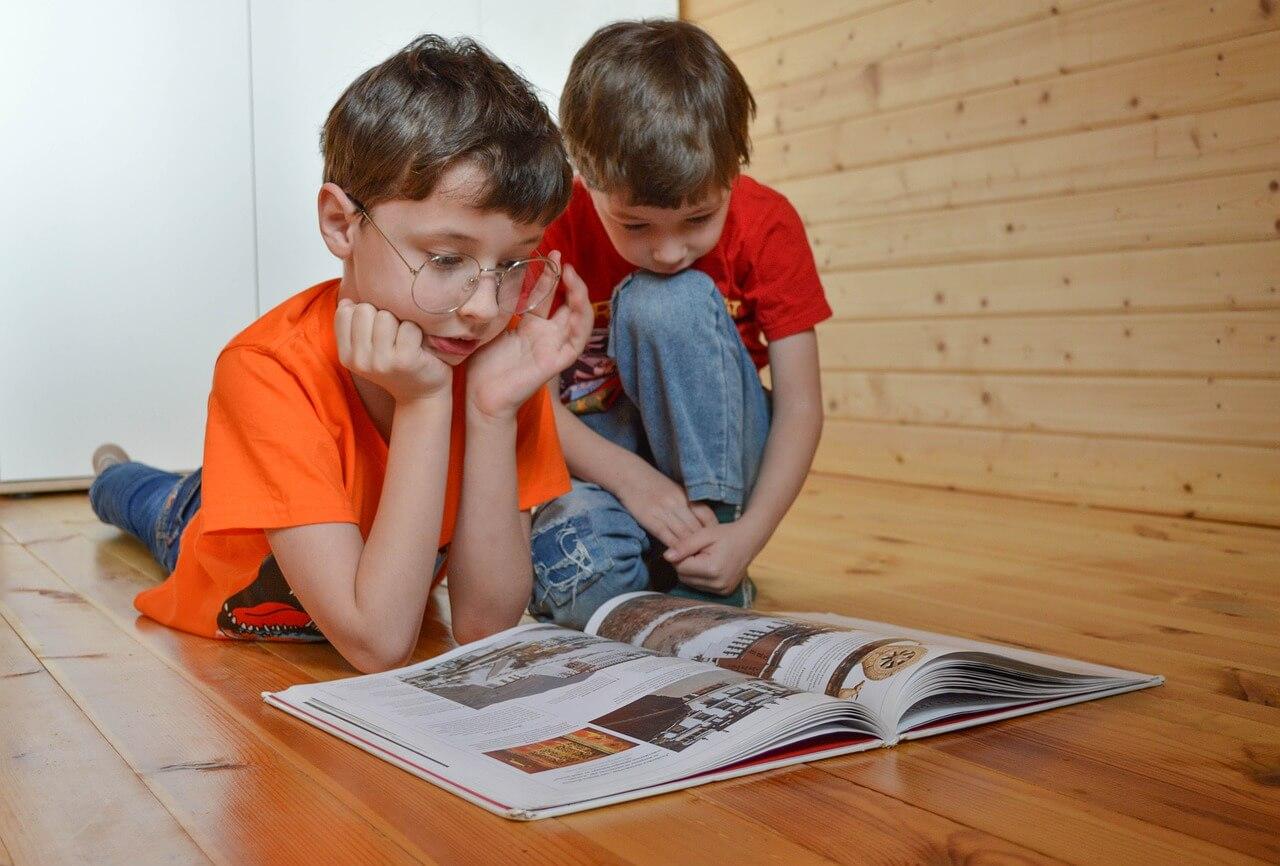 2 kids reading - eye care in Parker, CO