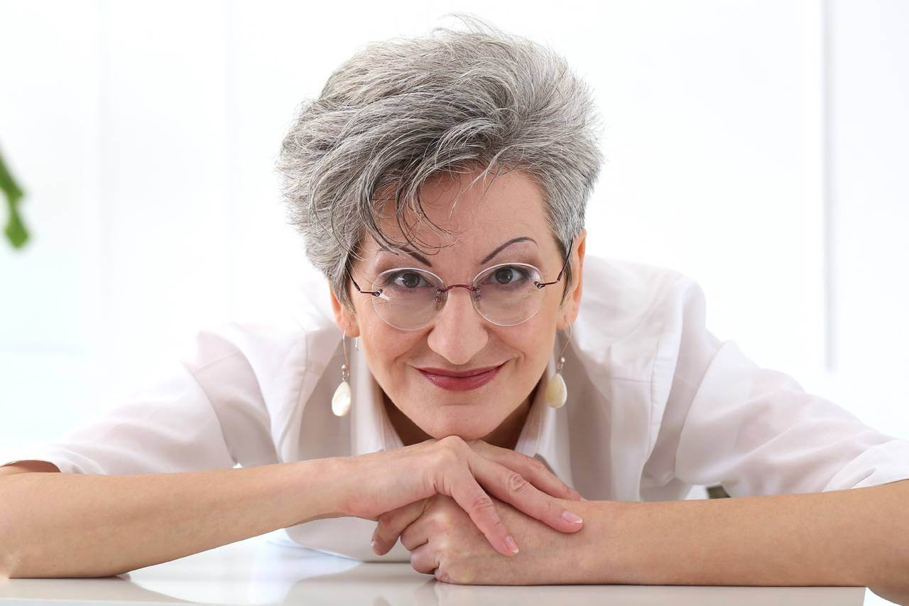 Older Woman Smiling Glasses 1280x853