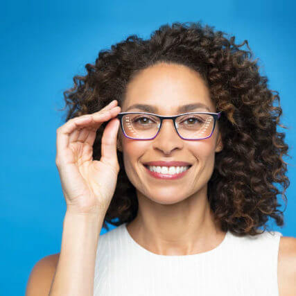 African American woman smiling and wearing Neurlens 427x427