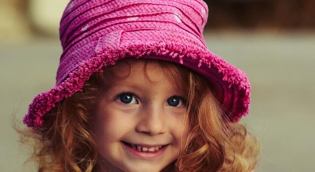 girl-with-cap-pediatric-eye-care.Calgary-AB-640x350-1