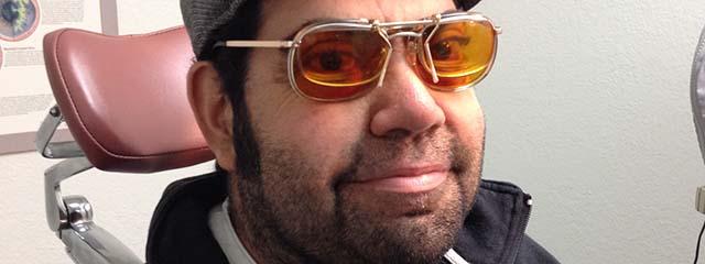 young guy wearing e-scoop eyeglasses