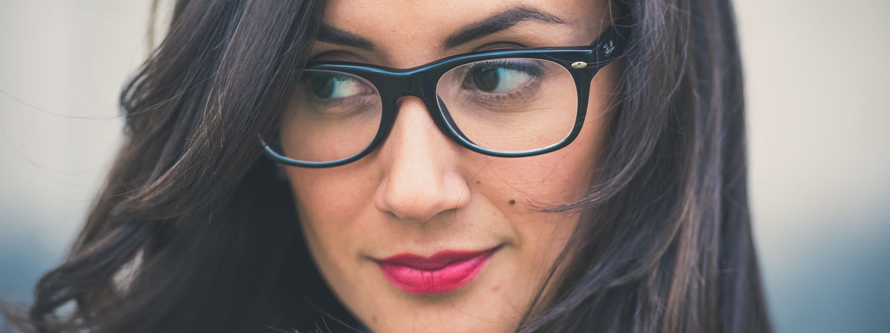 Eye care, woman with black hair and eyeglasses in Hartsdale, NY