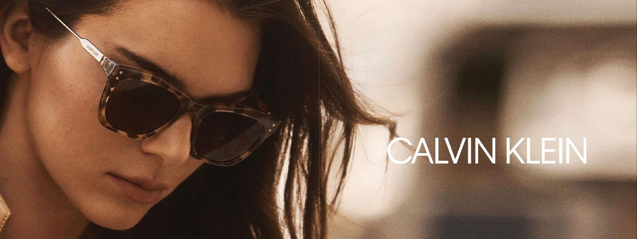 Eye doctor, man & woman wearing Calvin Klein eyeglasses in Hartsdale, NY