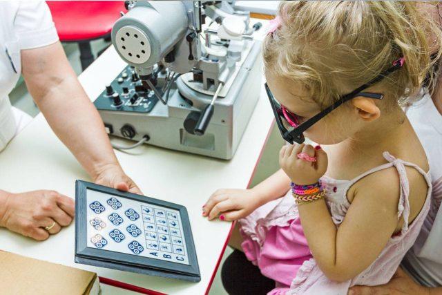Little girl having eye exam