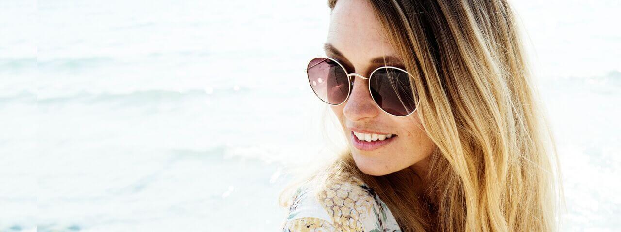 Woman wearing designer sunglasses