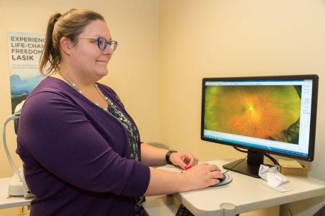 Melissa taking an Optomap retinal image compressed