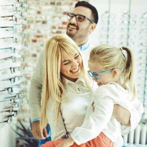 optometrist giving eye exam to boy