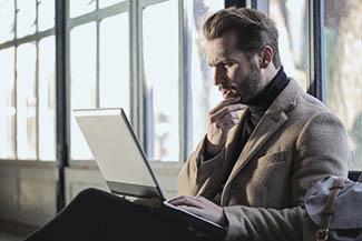 Man staring into his laptop in Olathe, Kansas
