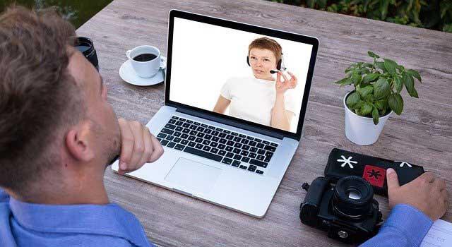 girl at laptop in Olathe, Kansas