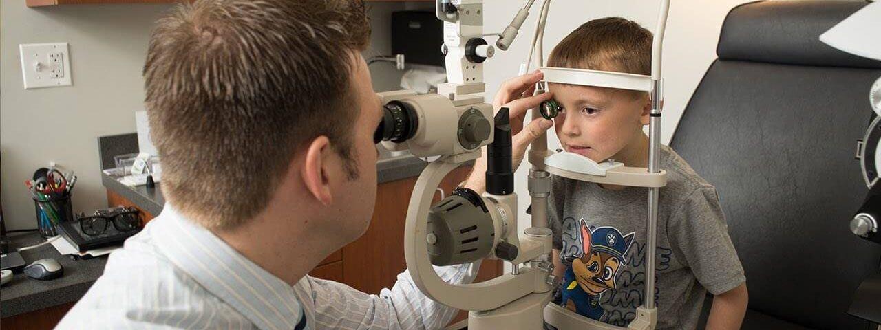 Optometrist, boy at an eye exam on San Francisco, CA