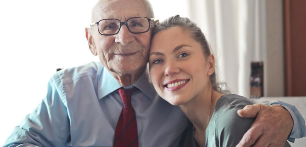 positive senior man in formal wear and eyeglass.1000×480.jpg