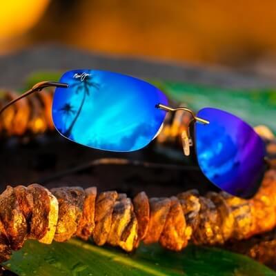 pair of blue tinted maui jim sunglasses