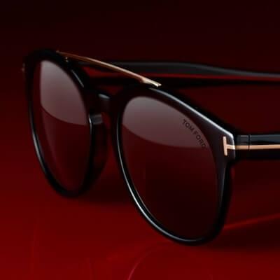 pair of tom ford sunglasses on dark background